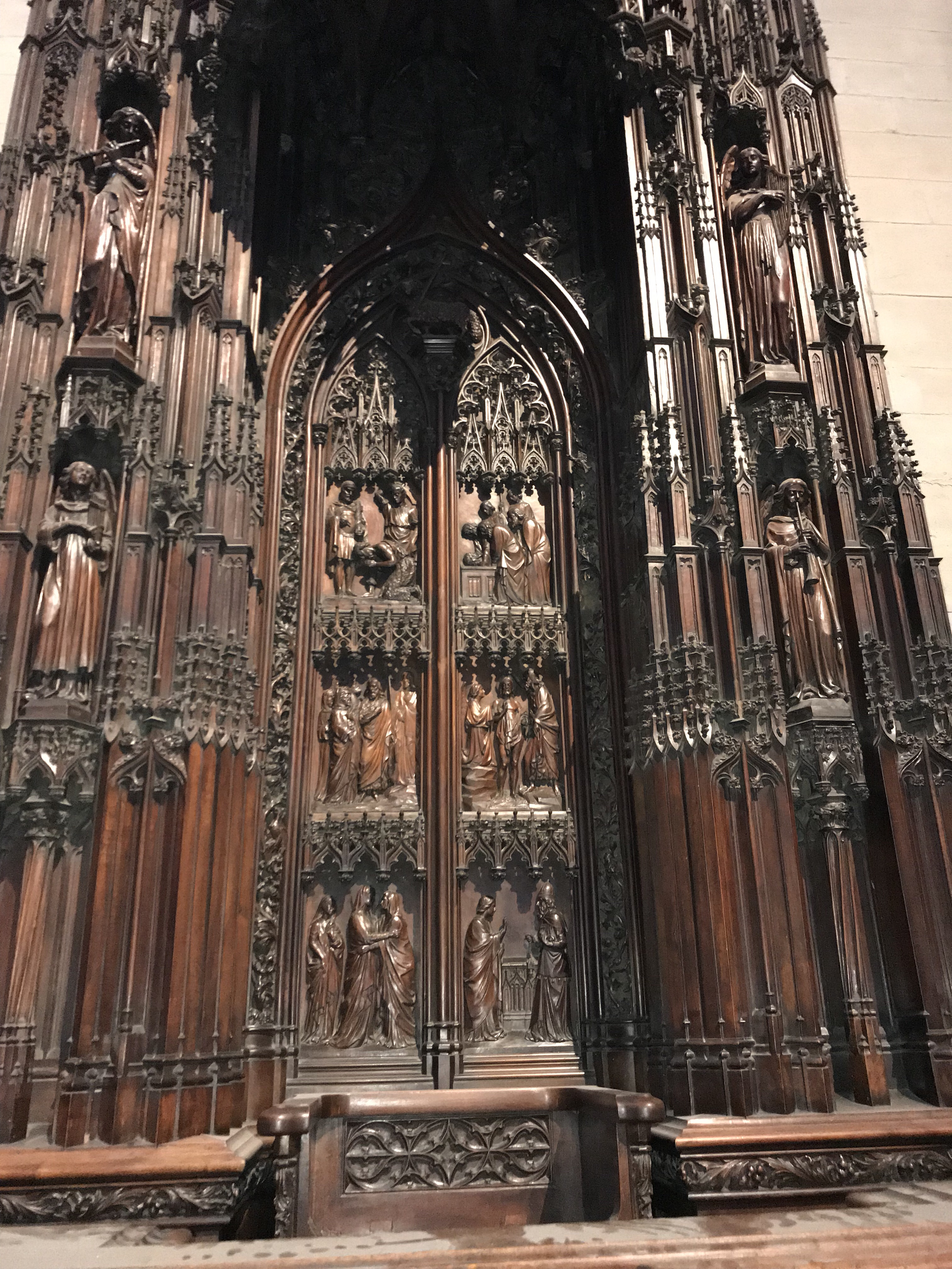 Carved wood piece from Lyon Cathedral. The panels on the doors in the center appear to depict the list of John the Baptist